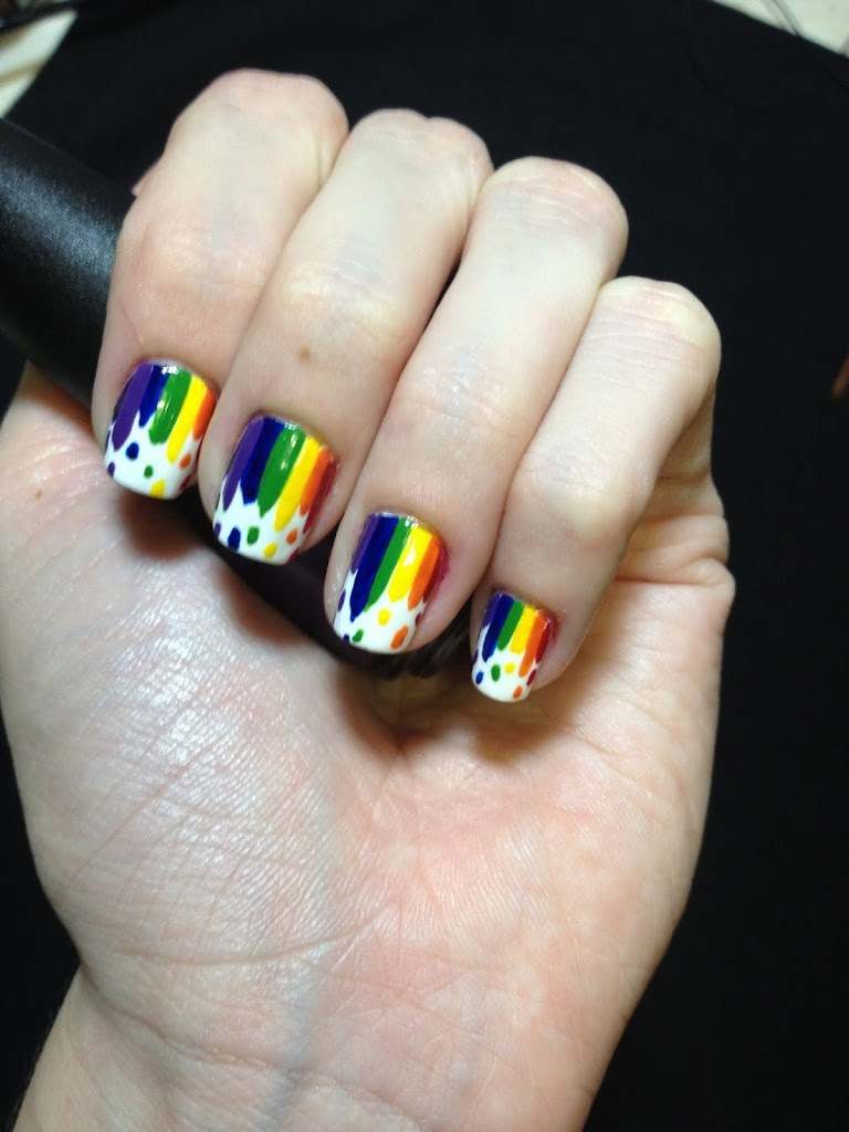 Dripping rainbow nails, four fingers